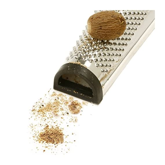 """Norpro Nutmeg Grater 5 Measures: 5.5"""" x 2.5"""" x 1.25"""" / 14cm x 6cm x 3cm Freshly ground nutmeg is so much more flavorful than pre-ground store bought nutmeg. With this handy little grater, you can have freshly ground nutmeg anytime you like. Add nutmeg to savory dishes, sweet dishes or as a drink topper. Features a handy compartment on top to store your nutmeg between uses."""