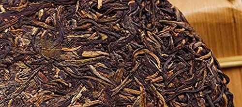 In 2003, the tea green printing special edition [Chunrui] Laosheng tea [fifty years of Chen Fang conversion] taste is very unique [Yunnan seven son cake tea] 2003 pressed old tea first class 2.5kg 357 by NanJie (Image #3)
