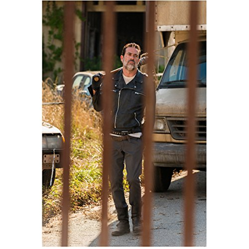 The Walking Dead (TV Series 2010 - ) 8 inch x10 inch Jeffrey Dean Morgan Bat Over Right Shoulder Black Leather Jacket Walking Toward Fence - Series Morgan Leather