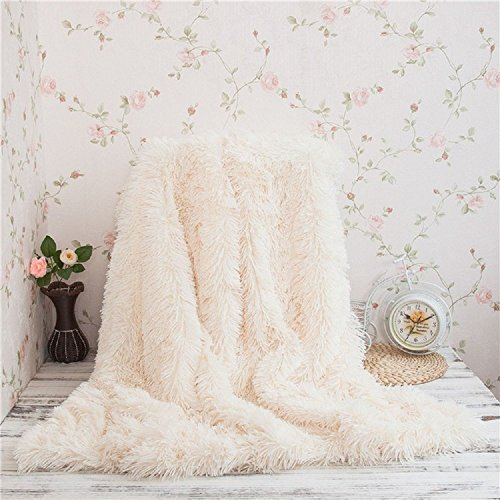 soft and cozy faux fur cream colored throw by FabricMCC