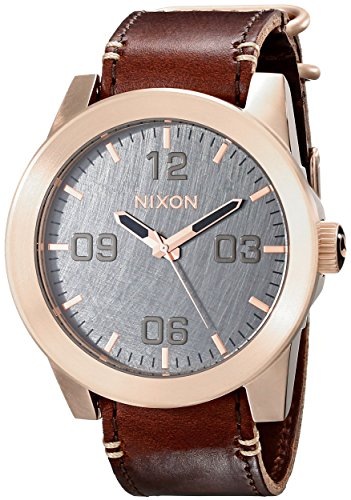 - NIXON Men's Corporal Series Analog Quartz Watch / Leather or Canvas Band / 100 M Water Resistant and Solid Stainless Steel Case