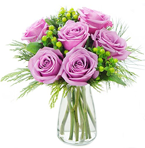 KaBloom Holiday Collection: Sugar Plum Purple Roses Accented with Green Berries and Seasonal Greens with Vase
