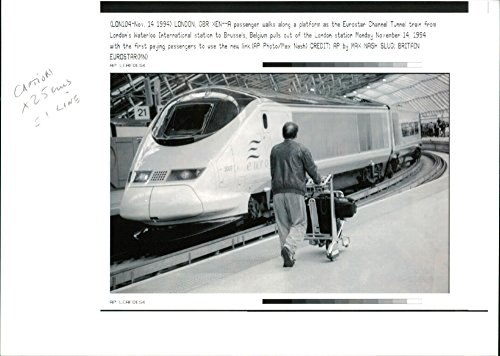 Vintage photo of A passenger walks along a platform as the Eurostar Channel Tunnel train from London39;s Waterloo International station to Brussels, Belgium.