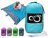 """Sand Free Compact Outdoor Beach Blanket- Huge-9' x 10' or 60"""" x 55"""" Pocket Sized Mat – Ideal For Festivals & Hiking- Very Soft & Quick Drying Nylon- Weightable Pockets + 4 Anchoring Loops & Stakes"""
