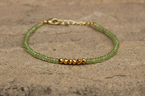 - Natural Peridot & Golden Pyrite Rondelle Roundel Faceted Beads Beaded 24k Gold Plated Bracelet 6 Inches