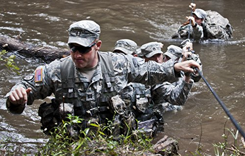 (Home Comforts Soldiers from the 6th Ranger Training Battalion cross the water and climb up the bank to reach a mem)