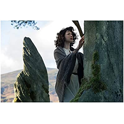 Caitiona Balfe as Claire Randall in Outlander Looking at Stone 8 x 10 inch Photo