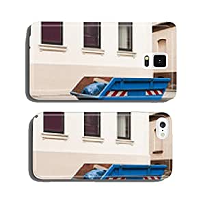 A blue container for waste stands before a House cell phone cover case iPhone5