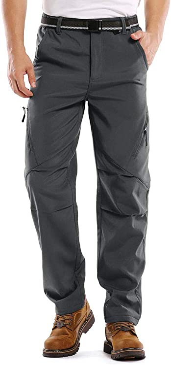 Photo of a man wearing a rain pants in gray color with his one hand inside the side pocket.