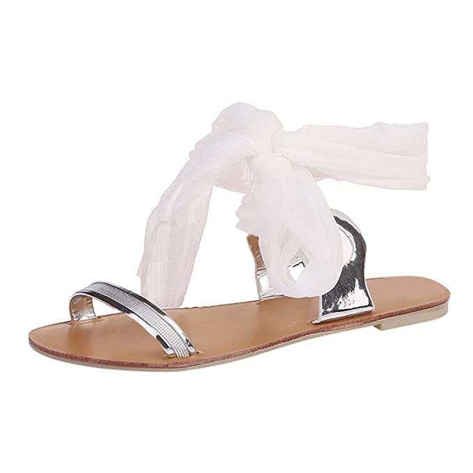 03d6477db Amazon.com  TnaIolral Women Sandals Cross Strap Ribbon Flat Ankle Roman  Shoes  Clothing