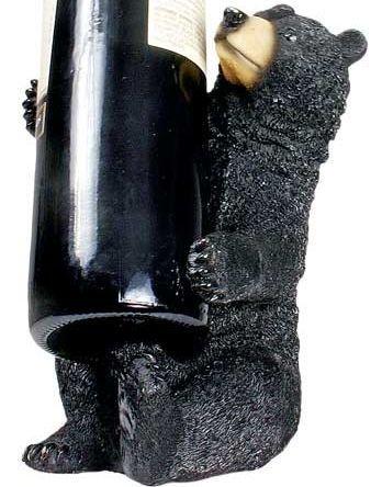 Sitting Figurine Holding Bottle Counter