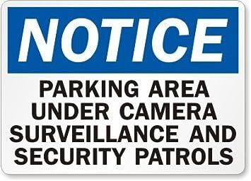 Aviso: Señal de vigilancia de zona de estacionamiento debajo de la cámara y patrullas de seguridad, 45 x 30 cm: Amazon.es: Oficina y papelería