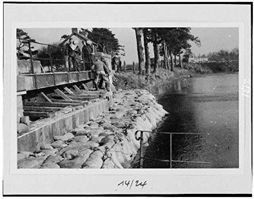 Photo: Men adding sandbags to dam,Baupte,France,World War II,WWII,1944 (Wwii Sandbag)
