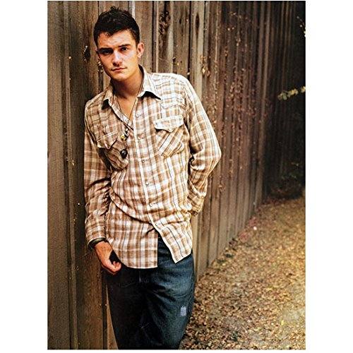 (Orlando Bloom 8 inch x 10 inch Photo The Hobbit Pirates of the Carribean Lord of the Rings Wearing Brown/White Plaid Shirt w/Right Shoulder Leaning Against Wooden Fence kn)