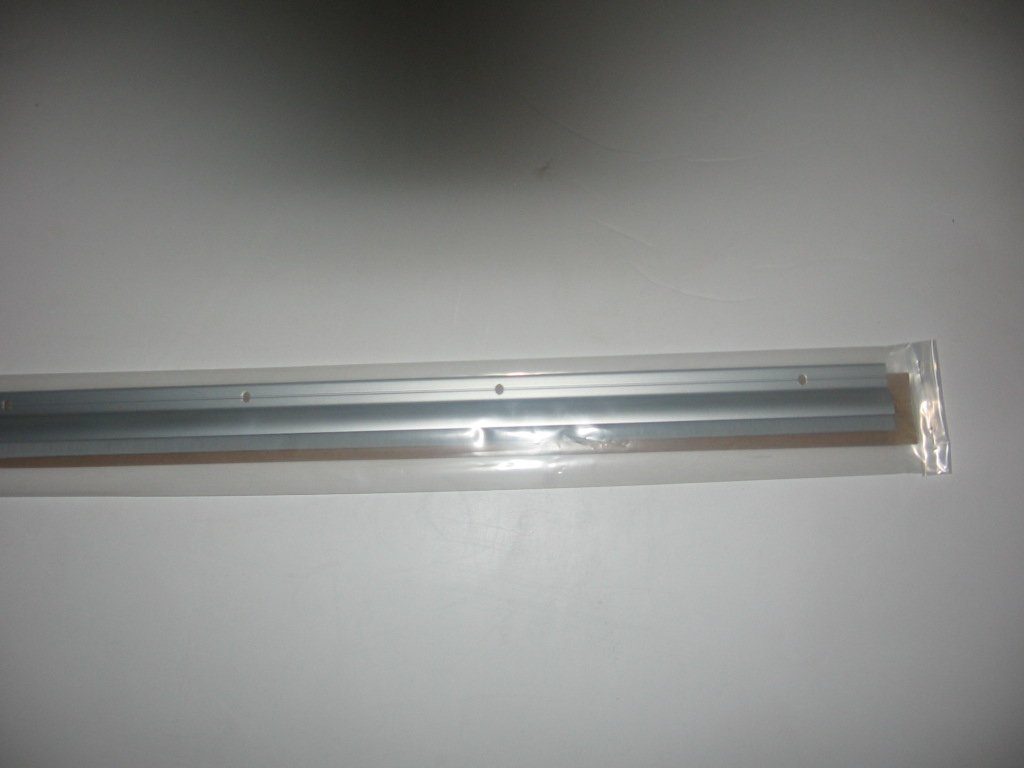 Pemko Brush Door Bottom Sweep with Rain Drip Clear Anodized Aluminum with Gray Nylon Brush Insert 0.5 W x 1.625 H x 36 L