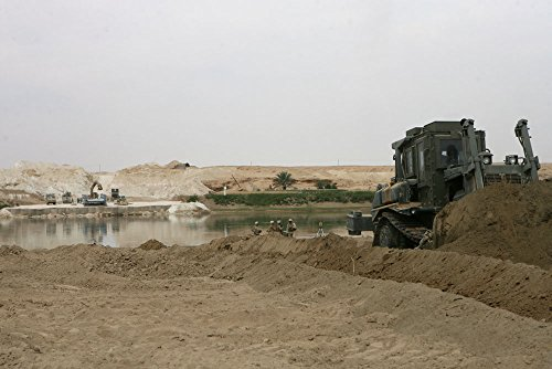 Navy Seabeas with Navy Mobile Construction Battalion 17, build a local bridge...