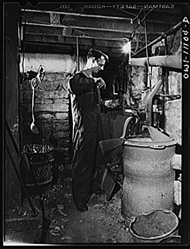 1942 Photo Lititz, Pennsylvania. This town of 4000-odd inhabitants, has two weekly papers, the oldest of which is the Record-express. Pouring molten metal, to make plates from mats in the basement of (Weekly Express Nature)