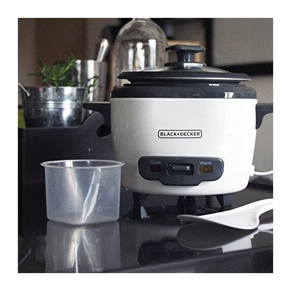 """BLACK+DECKER RC503 Dry/3-Cup Cooked Rice Cooker 12 Sauté Function - This is no ordinary rice cooker! The sauté function puts a delicious sear on meat and other proteins, or softens veggies to complete easy one-pot meals 14-Cup Capacity - Prepare anywhere from 3 to 14 cups of cooked rice, great for one large meal or to save as leftovers Automatic Keep Warm - The rice stays ready for serving! The unit automatically switches to the """"keep warm"""" function after cooking is complete"""