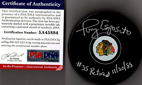 (Tony Esposito Autographed Hockey Puck - #35 Retired 11 20 98 84 - PSA/DNA Certified - Autographed NHL Pucks )