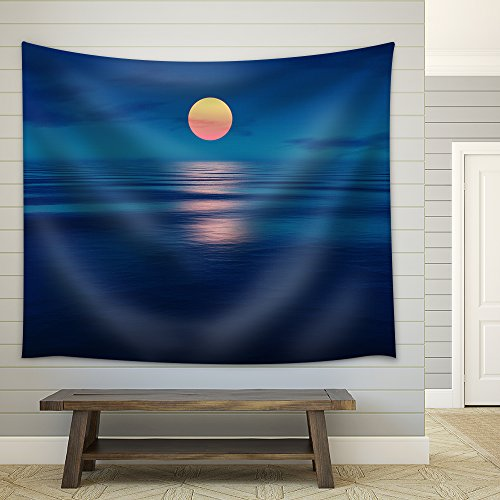an Image of a Beautiful Sunset Over The Ocean Fabric Wall