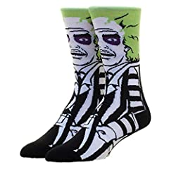 Beetlejuice, Beetlejuice, Beetlejuice. He has shown up on these comfortable socks. These crew socks are made from 200 needle construction for sharper detail and a softer feel. Fits sock size 10-13.
