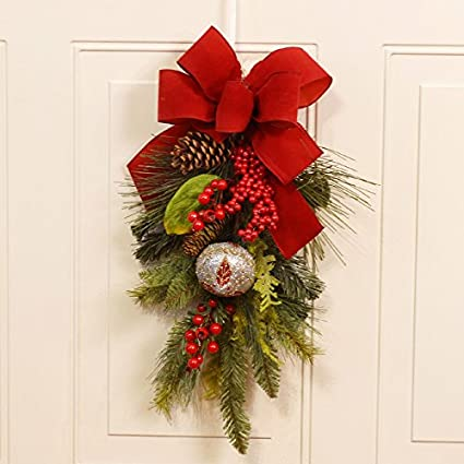 christmas door swag with jingle bells and red bow