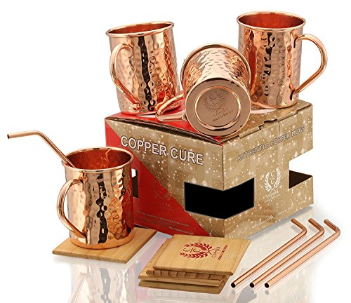 Copper Moscow Mule Mugs - Set of 4 - Highest Quality Gift Set – 100% HANDCRAFTED - Food Safe Pure Solid Copper Mugs 16 oz Hammered Moscow Mule Mug with BONUS:Copper Straws and Coasters by Copper Cure by Copper Cure (Image #1)