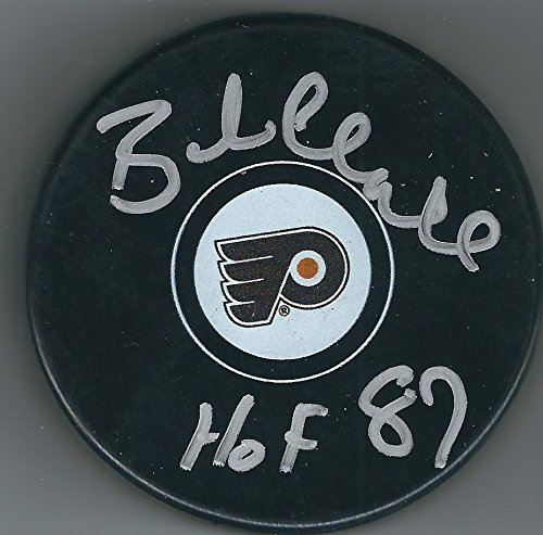 Autographed Bobby Clarke Flyers Hockey puck with HoF 1987 with COA