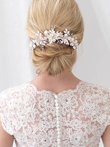 USABride Bridal comb offers a touch of nature inspired beauty to your bridal look This headpiece features ivory enamel flowers accented with frosted leaves and hand-wired sparkling rhinestones TC-2303 by USABride