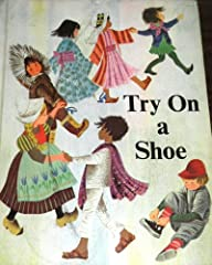 A boy and girl try on the shoes of children around the world.