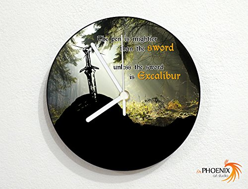 The Pen Is Mightier Than the Sword Unless the Sword Is Excalibur - Wall Clock by inPhoenix