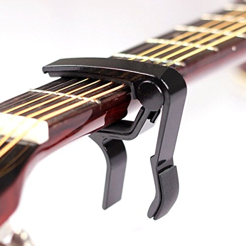 trigger capo for electric and acoustic guitars in black buy online in oman musical. Black Bedroom Furniture Sets. Home Design Ideas