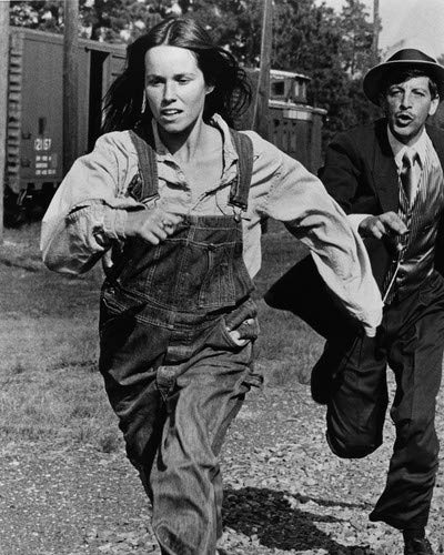 - Barbara Hershey and Barry Primus in Boxcar Bertha run beside freight train 16x20 Poster