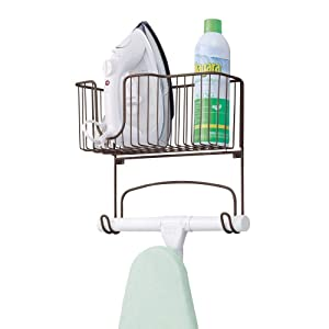 mDesign Metal Wall Mount Ironing Board Holder with Large Storage Basket - Holds Iron, Board, Spray Bottles, Starch, Fabric Refresher for Laundry Rooms - Bronze