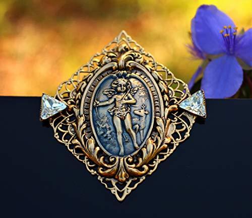 Angel Cupid with deer gold tone filigree enamel Brooch by Inga Engele USA 60mm x 52mm