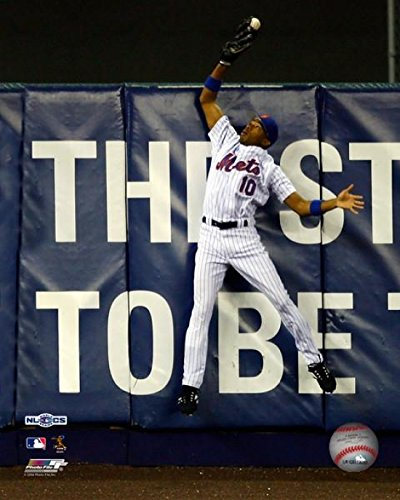 Endy Chavez #10 catches a ball hit in the sixth inning hit by Scott Rolen #27 during Game Seven of the NLCS at Shea Stadium on October 19 2006 Photo Print (8 x 10)