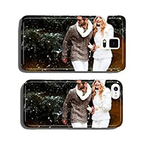 Happy couple near a Christmas tree. Christmas Eve. cell phone cover case iPhone6