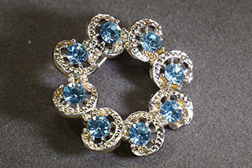 - Gold Tone Circle Brooch Pin With Crystal Blue Faceted Rhinestones