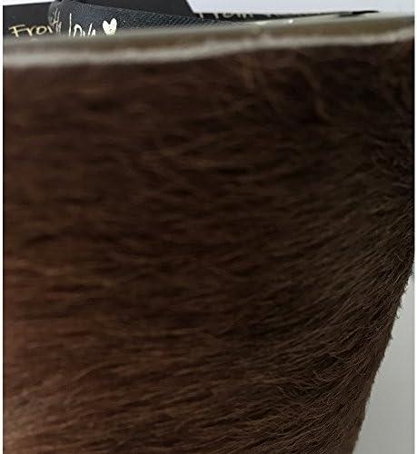 Grande bougie /él/égante avec une fourrure brune et deux m/èches 9 cm de haut et /Ø 10 cm.