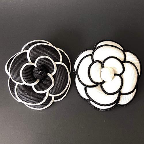 Camellia Brooch]()