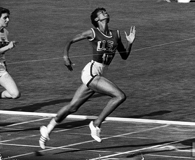 Amazon photo black track star wilma rudolph 20 lunging across photo black track star wilma rudolph 20 lunging across the finish line as she wins 100 voltagebd Choice Image