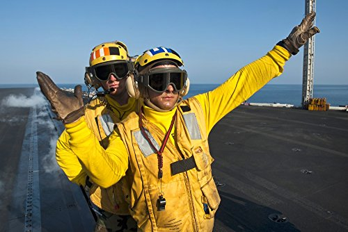 Aviation Boatswains Mate (Aviation Boatswain Mates direct an aircraft aboard USS John C Stennis Poster Print (34 x 22))