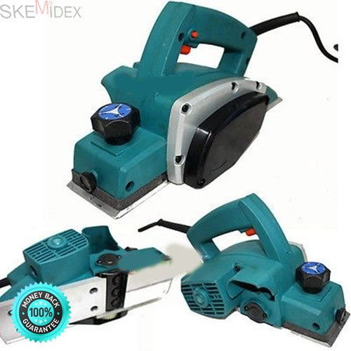 SKEMiDEX---500W 3 1/4'' ELECTRIC WOOD PLANER WOOD WORKING. Spring-loaded stand elevates tool to protect blade and tool resting spot; special shape allows easy entry in middle of workpiece