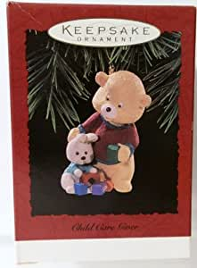 "Older Teddy Bear Watching Over Baby Bunny ""Child Care Giver"" Christmas Ornament - Hallmark Keepsake 1996 Series"