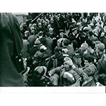 Vintage photo of Tension between people and group of police in Algeria.