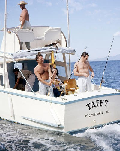 Elizabeth Taylor 11x14 Promotional Photograph With Bare Chested Richard Burton Fishing on their Taffy boat in Mexico