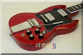 ANGUS YOUNG Miniatura Guitarra AC/DC