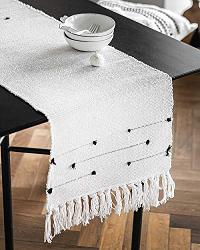 Moroccan Fringe Table Runner 14 X 72 in, KIMODE Bohemian Geometric Cotton Woven Tufted Tassels Macrame Farmhouse Dinning Table Linen Machine Washable Minimalist Home Decorative - FITS TABLES FOR 4 to 6 PEOPLE: 14 in x 72 in ( Length 72 inch not include tassel ); macrame runner with extra in long handmade woven snazzy tassels on each side,gives a chic feeling and creates a relaxed mood in your room. CLASSY MATERIAL AND UNIQUE DESIGN: Fringe table runner use exquisite cutting with premium quality cotton and hemp fabric,add fringe and tufted vibe on this table runner,black and white colored lines looks more romantic and minimalist. MULTIFUNCTIONAL UTILIZATION: Suitable for most rectangular table, round table, and square table, and it not only moroccan decor dining table but also tea table, shoe cabinet, and TV stand, etc;great gift at housewarmings, holidays and birthdays. - table-runners, kitchen-dining-room-table-linens, kitchen-dining-room - 51RBIvZoFUL -