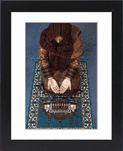 Framed Print of Muslim woman kneeling on prayer mat saying prayers, Jordan, Middle East by Robert Harding