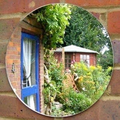 Espejo de pared redondo para jardín. 45 cm Diameter Efecto espejo: Amazon.es: Hogar